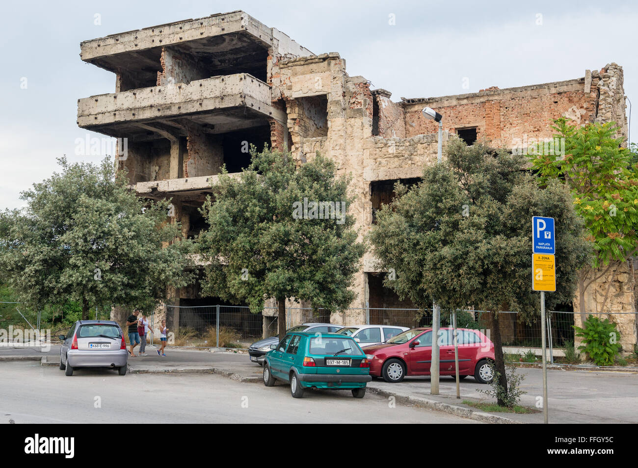 Abandoned building, detroyed during Bosnian War at Bulevar Street in Mostar city, Bosnia and Herzegovina Stock Photo