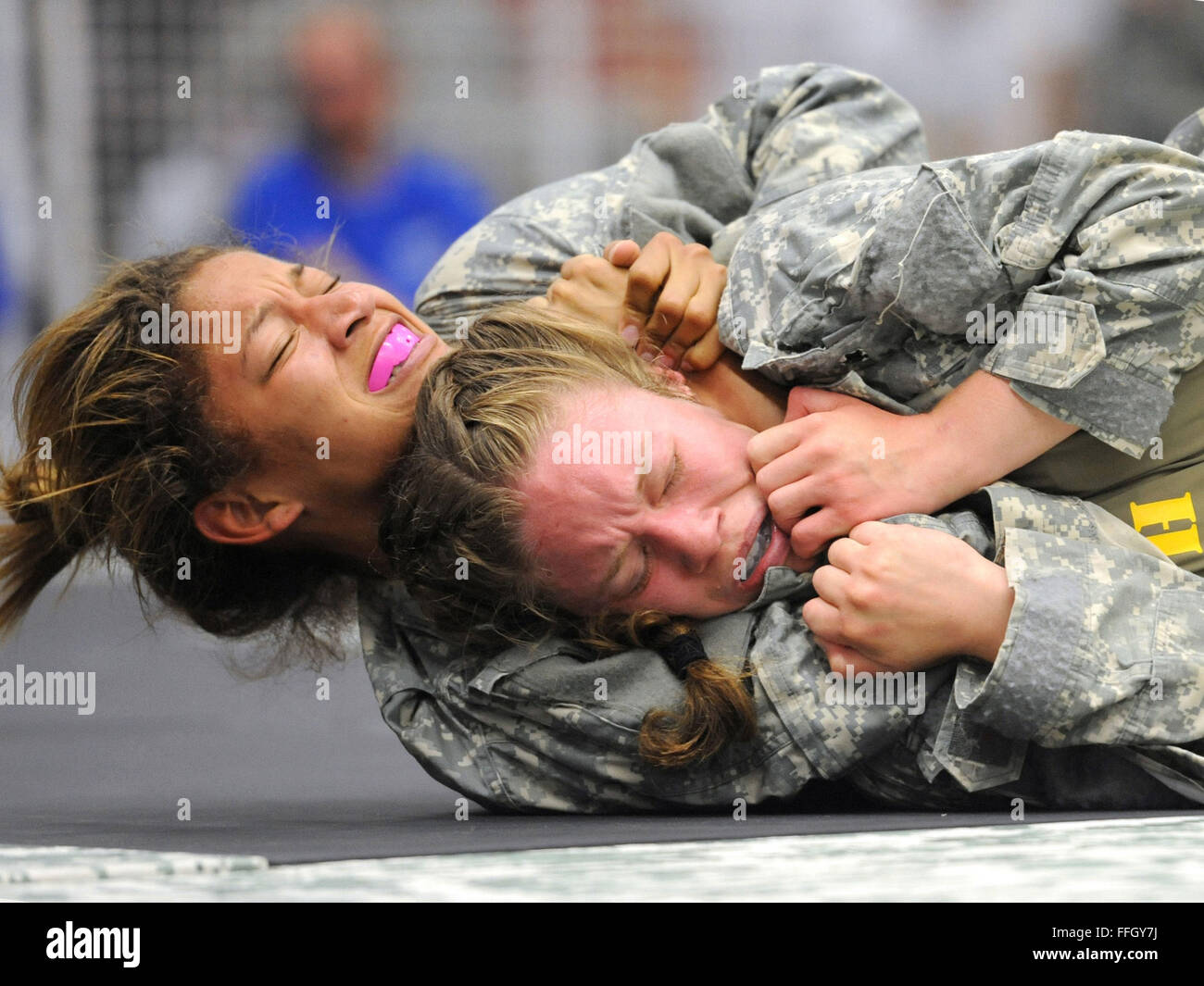 Army 1st Lt. Courtney Olofsson (front right) tries to escape a choke hold by Staff Sgt. Alyssa Johnson during the - Stock Image