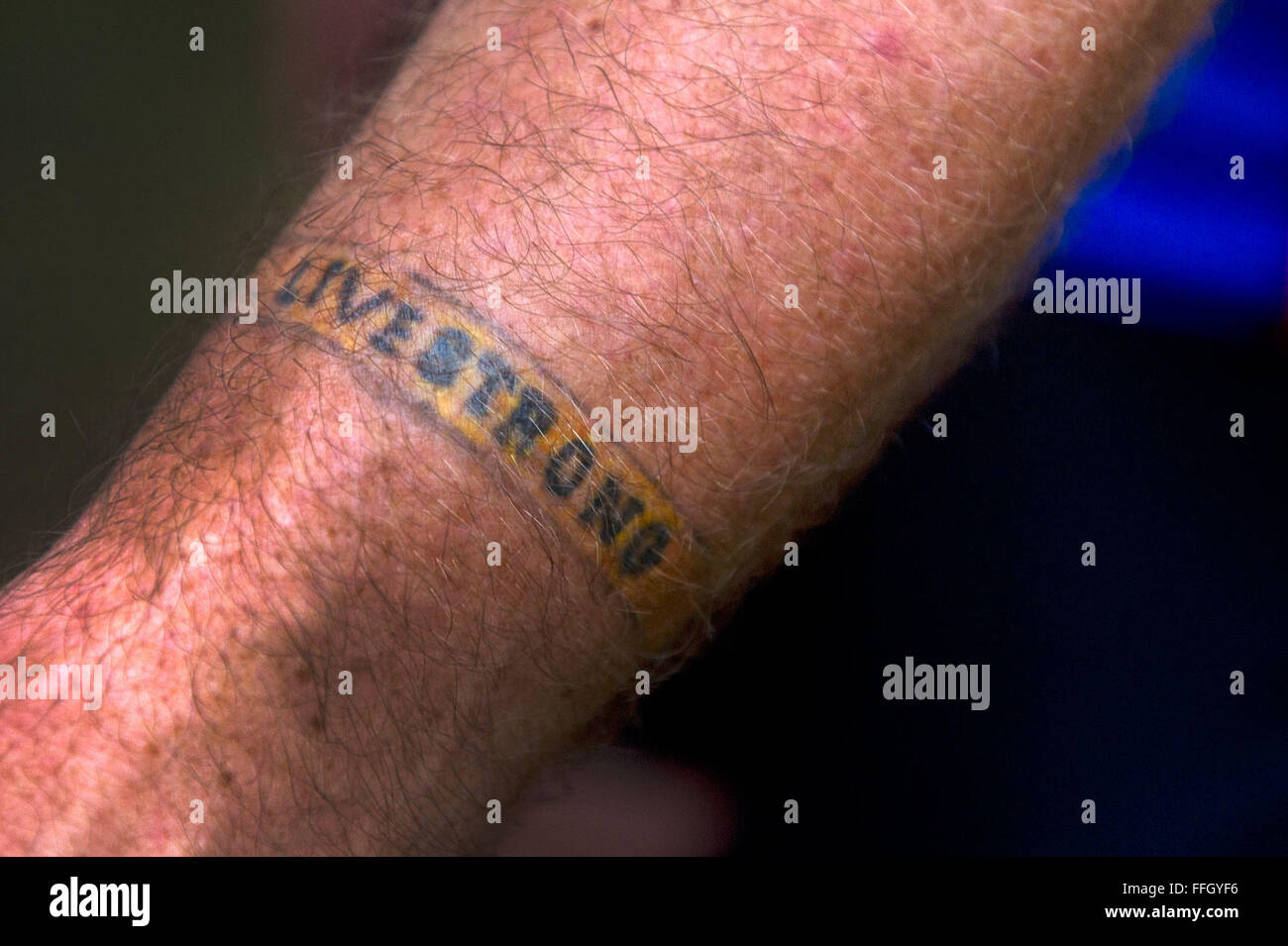 RAGBRAI participant Kevin Swensen has a Livestrong bracelet tattooed on his arm to show his support for his father's - Stock Image