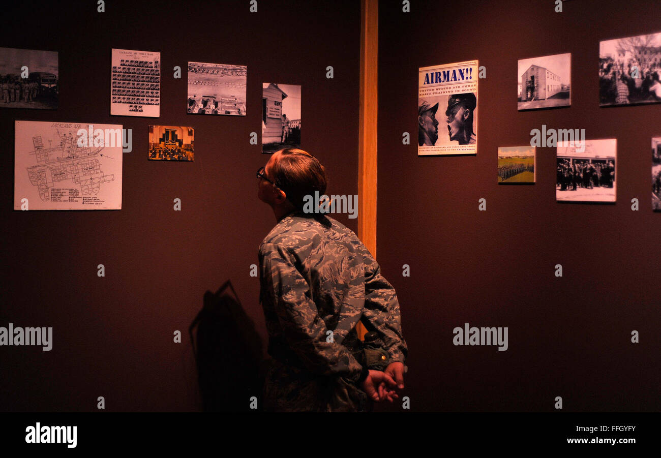 A basic trainee examines a collection of historical images of Air Force basic military training in the 1950s at - Stock Image