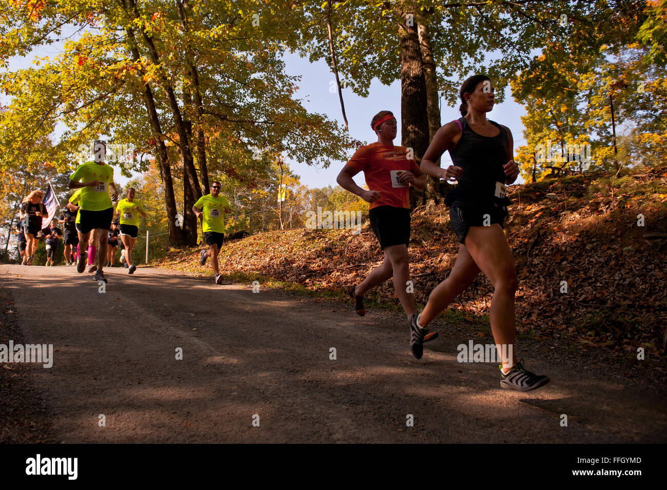 Runners begin the first decline of the 8-kilometer mountain run of the Wilderness Challenge. The runners had to - Stock Image