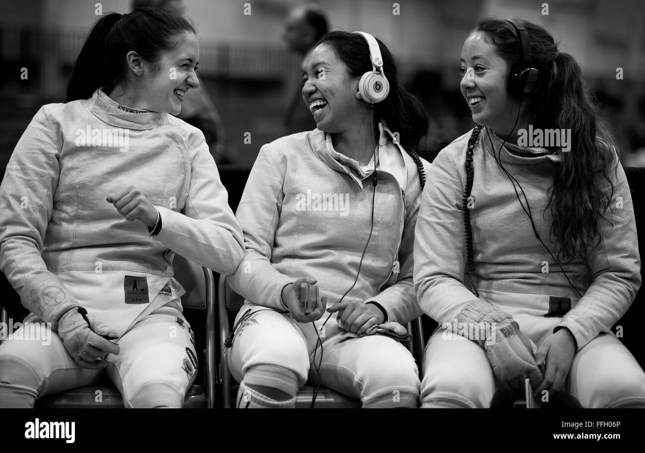 Alyssa Hofilena shares a laugh with two other fencers during the 2014 NCAA Fencing Championships at Ohio State University - Stock Image