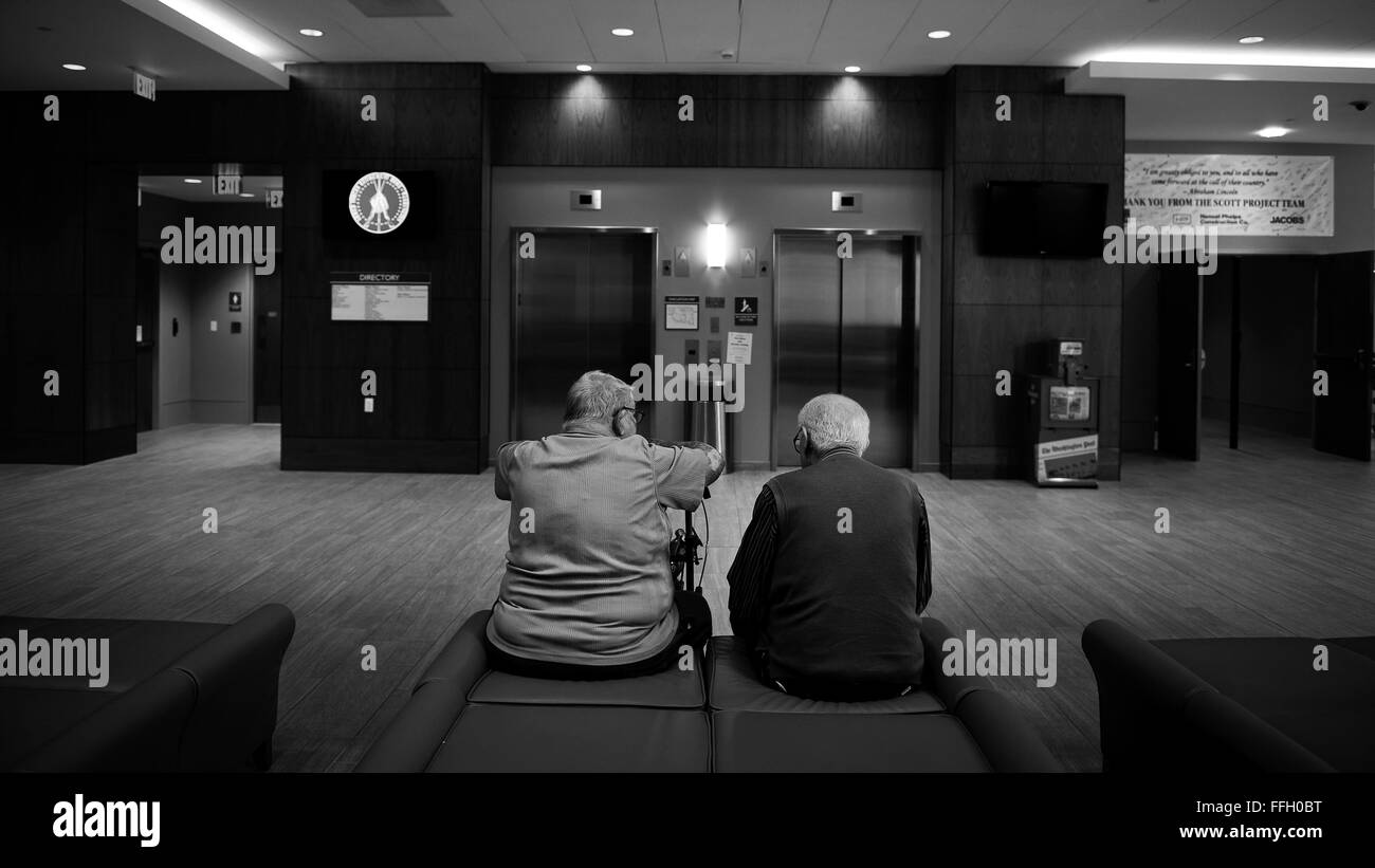 Bill Castle and Norman Godfrey, both residents at the Armed Forces Retirement Home, sit and talk after lunch. - Stock Image