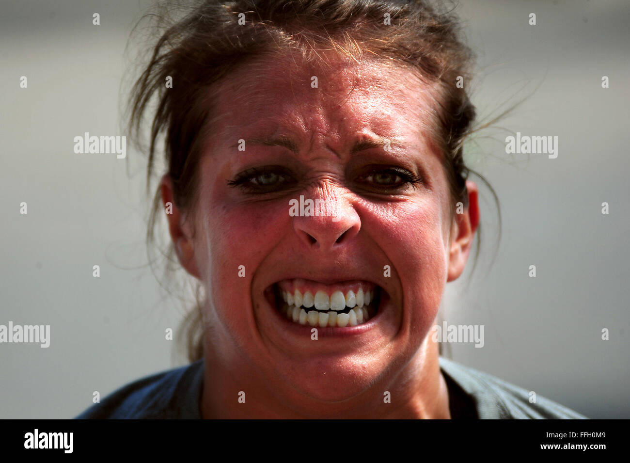 A competitor stresses during CrossFit Integrity, the Charleston CrossFit games Oct. 6, 2012, in Charleston, S.C. - Stock Image