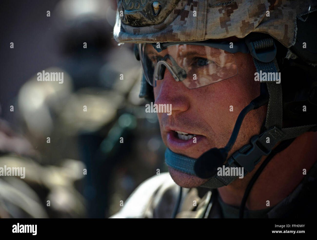 After rallying up close to the location of the injured players in a mass casualty extraction exercise, a Marine - Stock Image