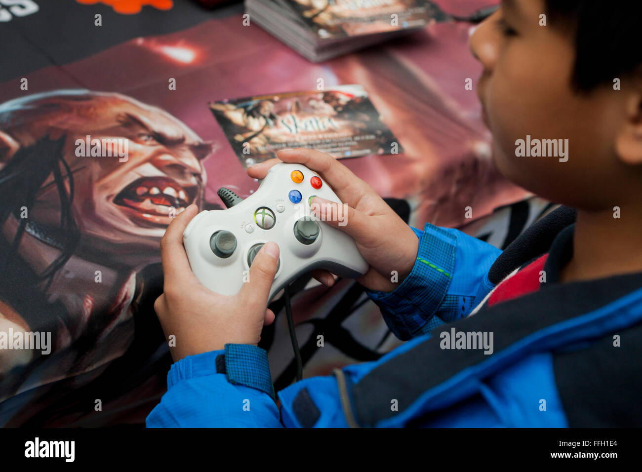 Child holding an Xbox 360 game controller unit - USA - Stock Image