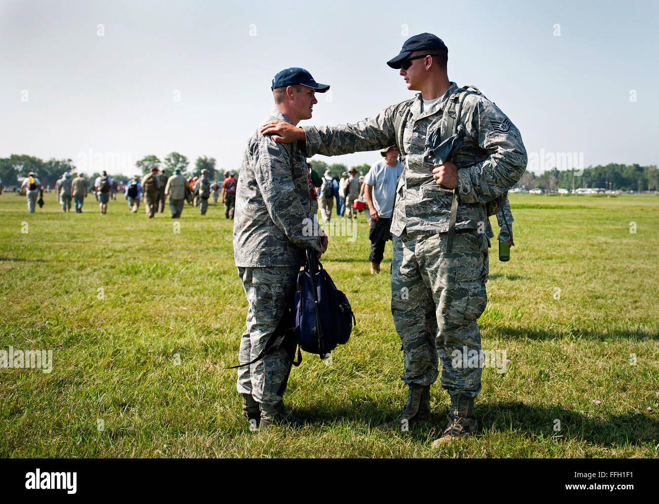 Staff Sgt. Timothy Hessel and Special Agent David Ohlinger talk and compare scores during the rifle competition - Stock Image