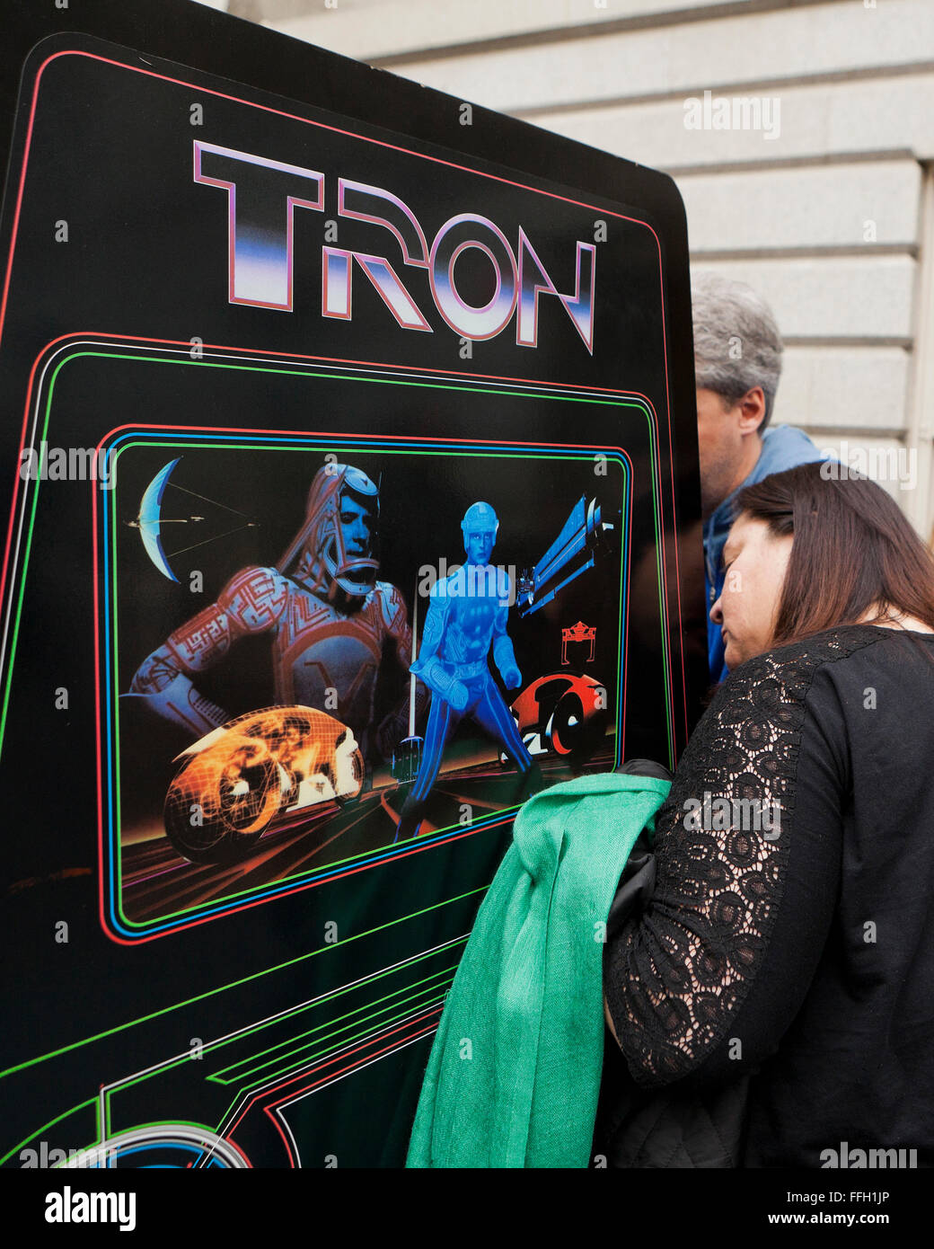 People playing Tron arcade video game - USA - Stock Image