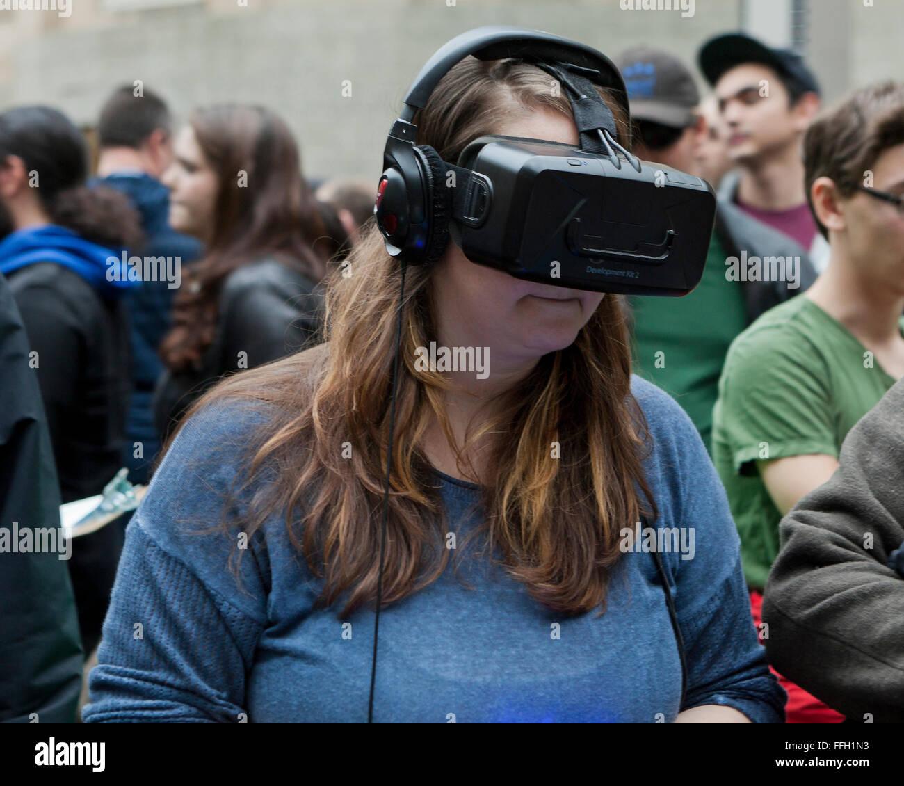 Woman wearing a virtual reality headset - USA - Stock Image