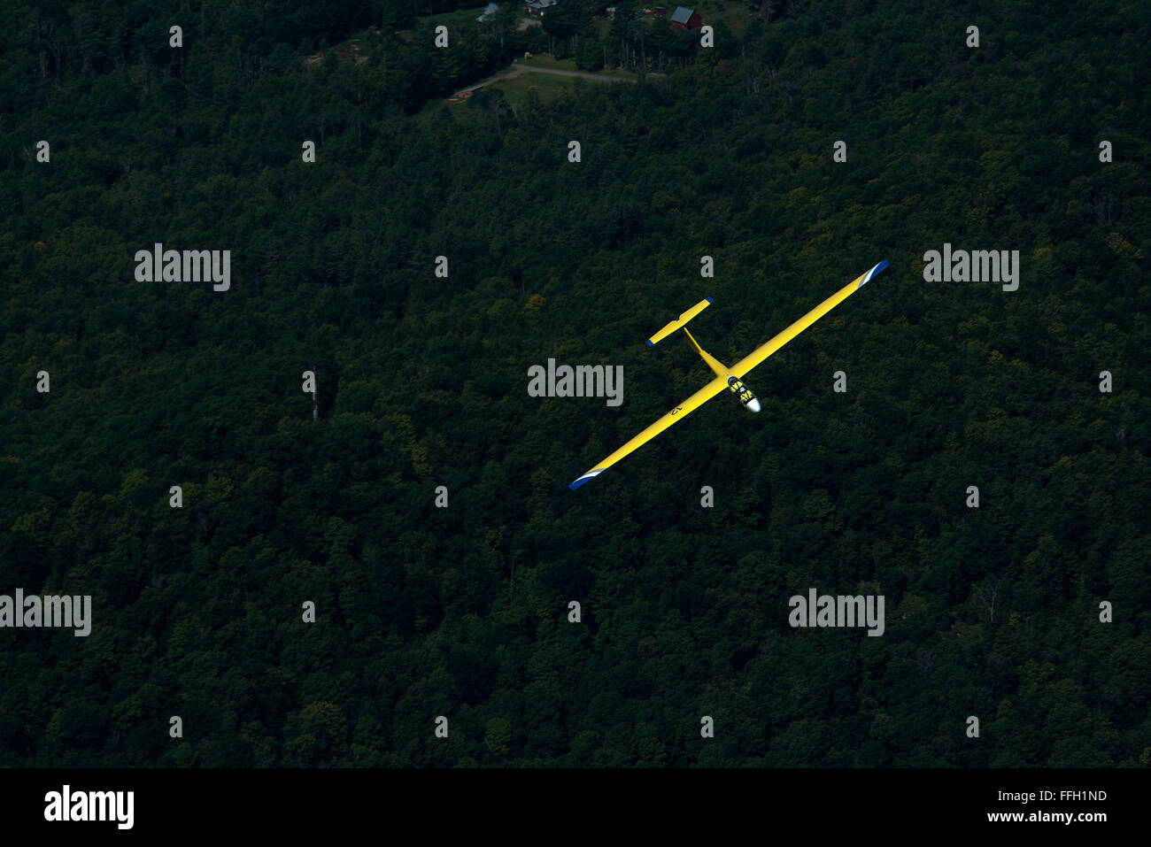 An L-23 Super Blanik glider turns right after disconnecting from a tow plane in the skies above Springfield Vt. - Stock Image