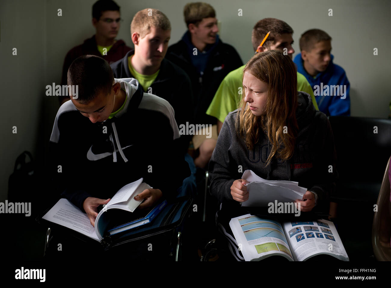 Civil Air Patrol cadets, Chris Cashman and Liz Bell, review their notes and study material before a ground school - Stock Image