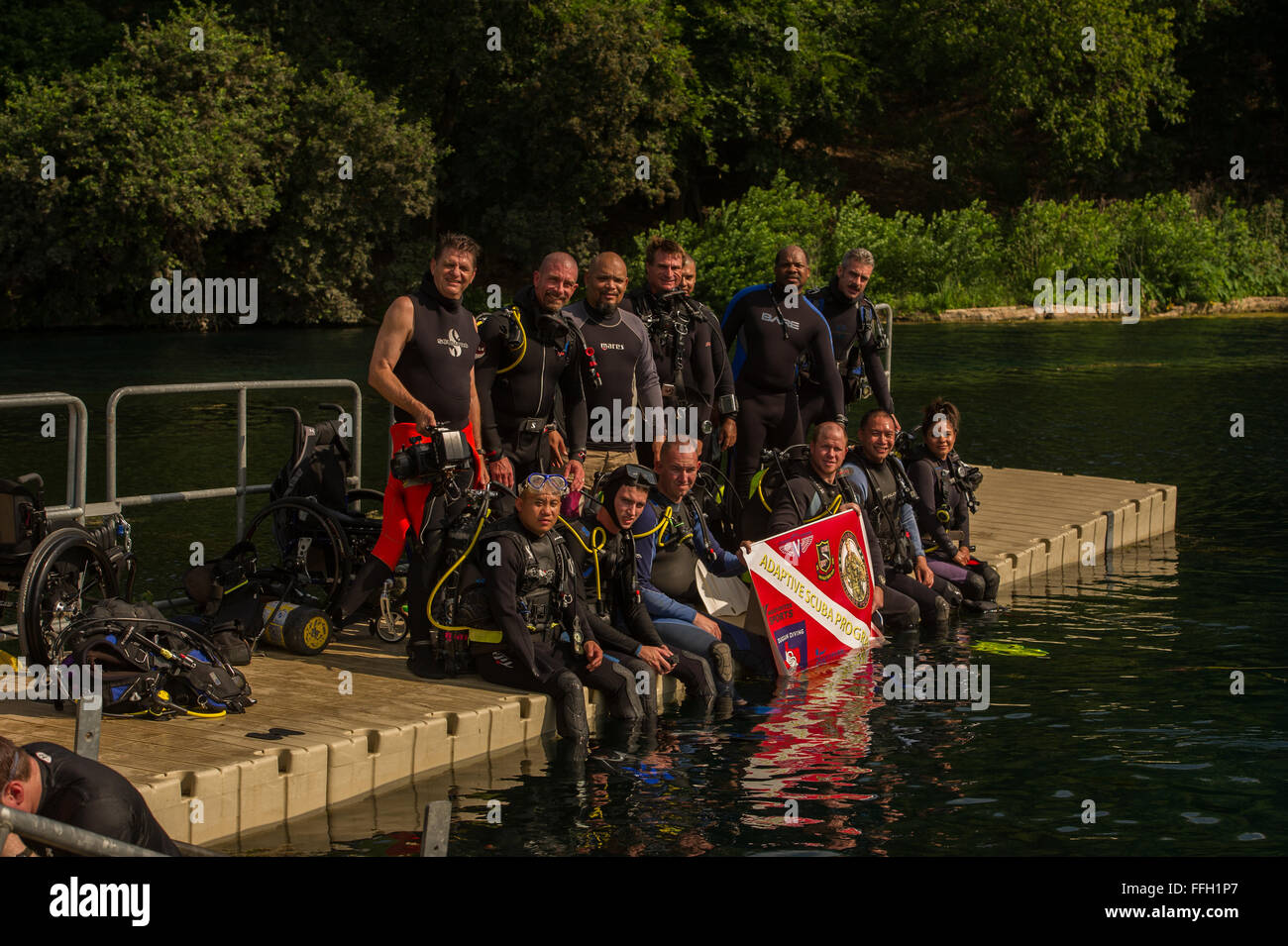 Wounded Warriors takes a group photo before starting a scuba diving class at Spring Lake in San Marcos, Texas. The - Stock Image