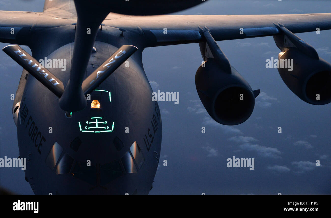 A C-17 Globemaster III is guided into position behind the boom of ...
