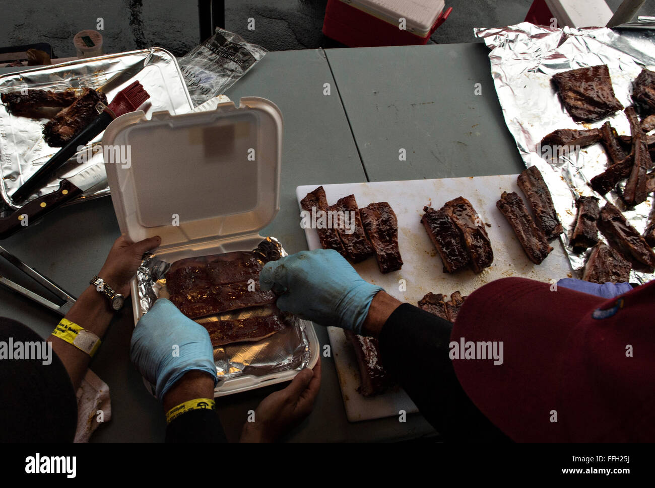 When competing in the barbecue rib category, Tech. Sgt. Todd Houghton will cook no less than six racks of ribs to - Stock Image