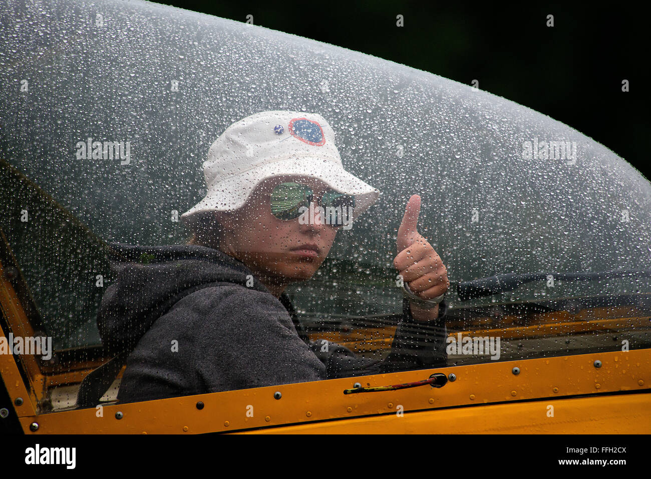 Civil Air Patrol Cadet, Liz Bell, signals to her wing-runner that she is ready for take-off on a solo flight in - Stock Image