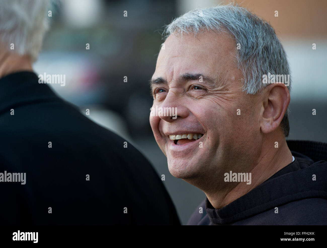 Retired Chaplain (Lt. Col.) Robert Bruno laughs with his fellow friends and priests before touring the Basilica - Stock Image
