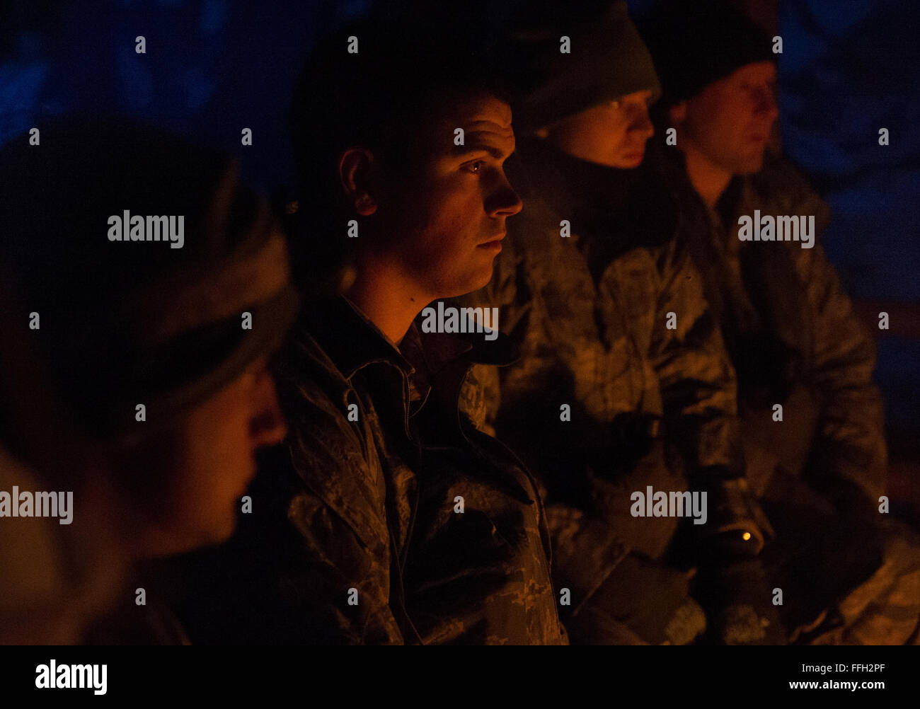 Students listen as Staff Sgt. Ryan Rogers, Det. 1, 66th Training Squadron, Arctic Survival School instructor, explains - Stock Image