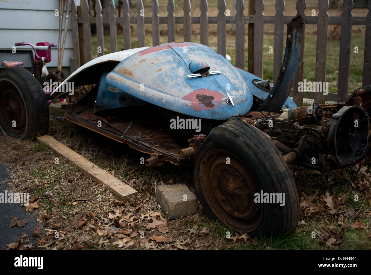 A pile of rusted parts from a 1958 Volkswagen Beetle sit on the side Master Sgt. Randy Rollins' house awaiting - Stock Image