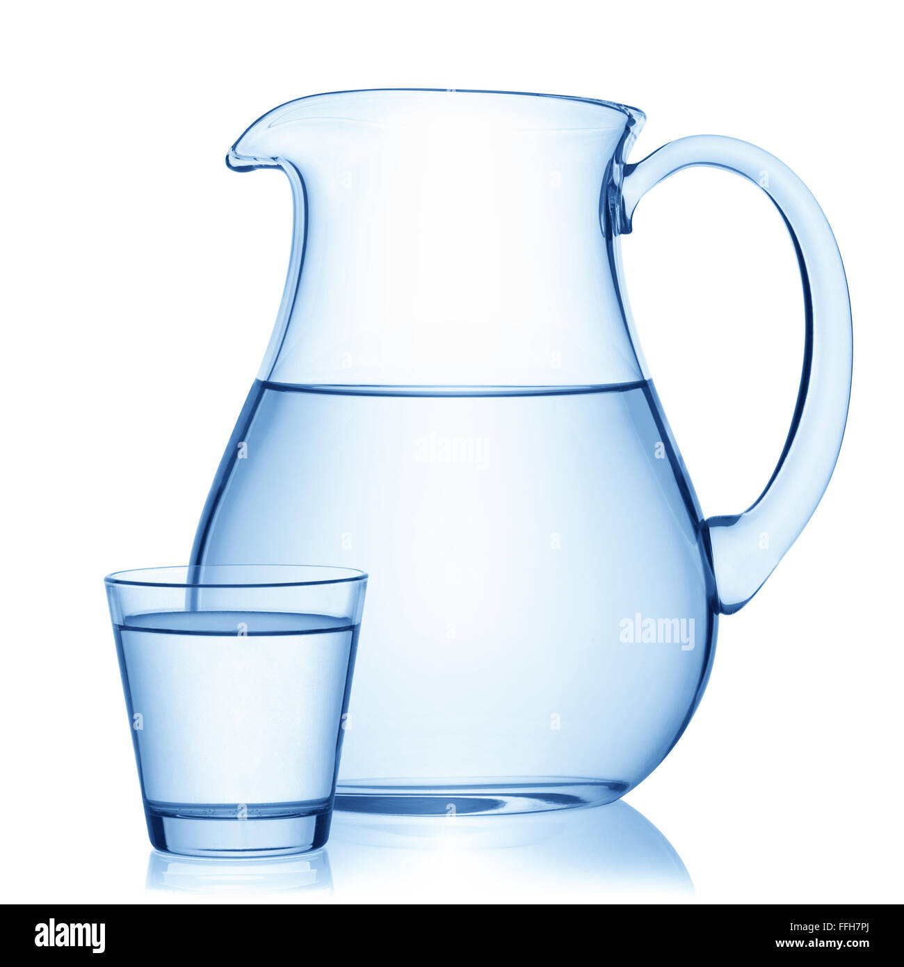 Pitcher and a glass of water, isolated on the white background, clipping path included. - Stock Image