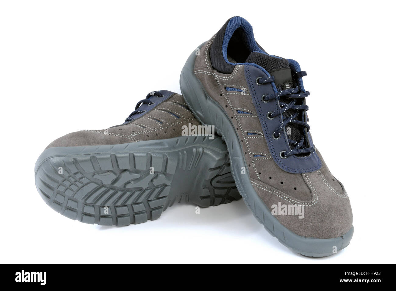 Protective work shoes for heavy work at the construction site - Stock Image