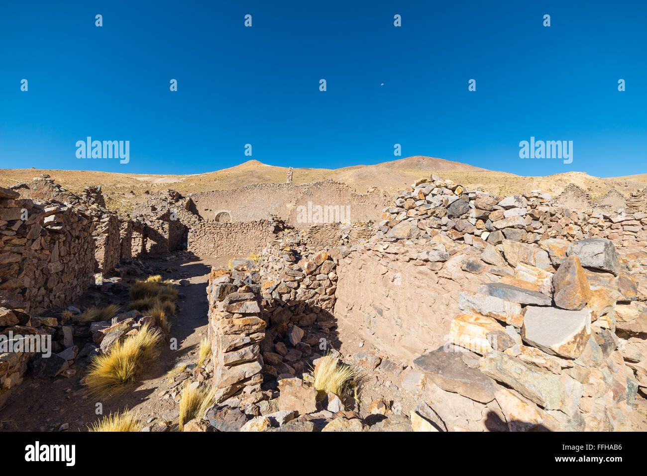 Abandoned and ruined old colonial village and mining town on the highlands of the Andes on the way to the famous - Stock Image