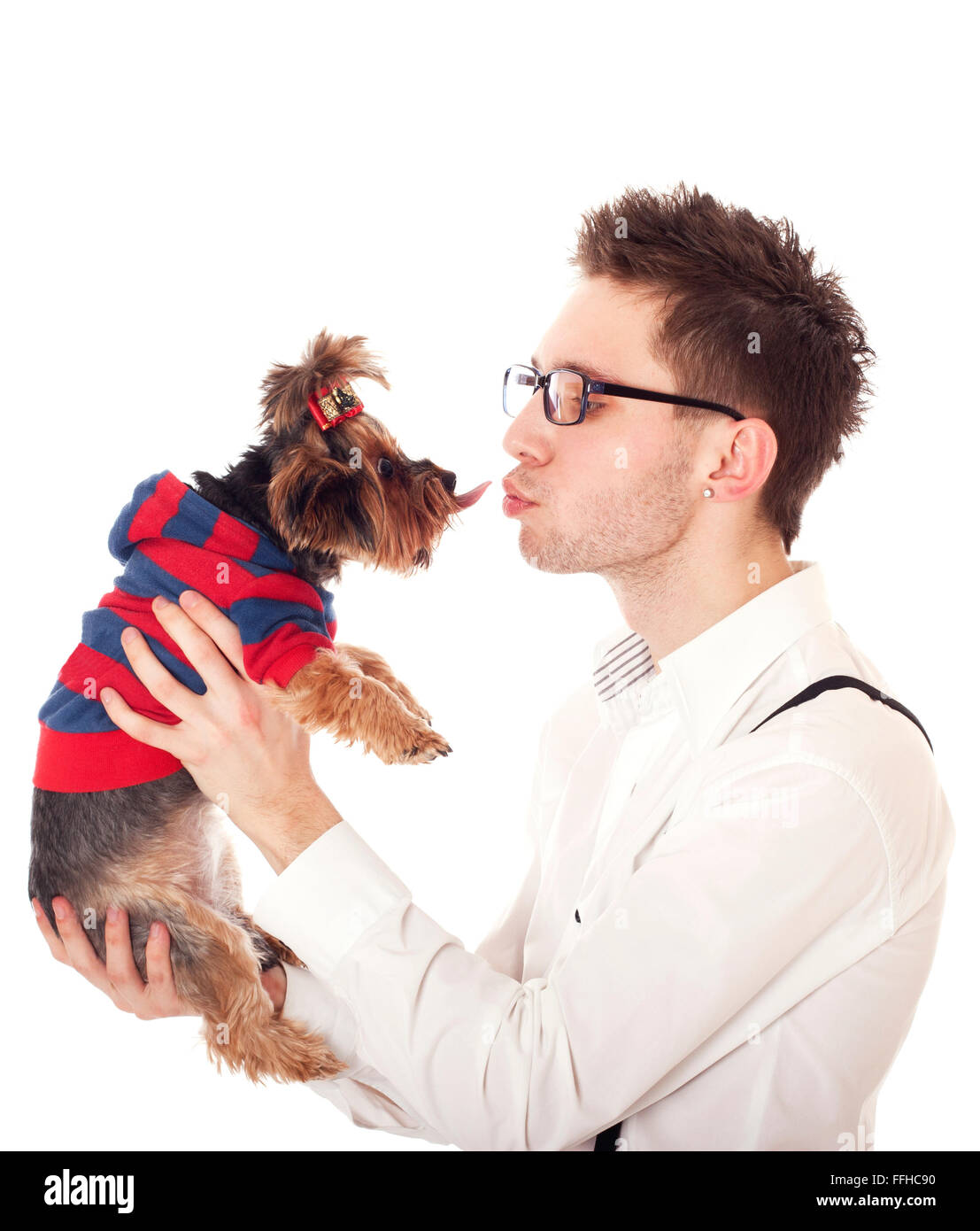 Man holding his pet Yorkshire Terrier in front of his face. Isolated on white. Stock Photo