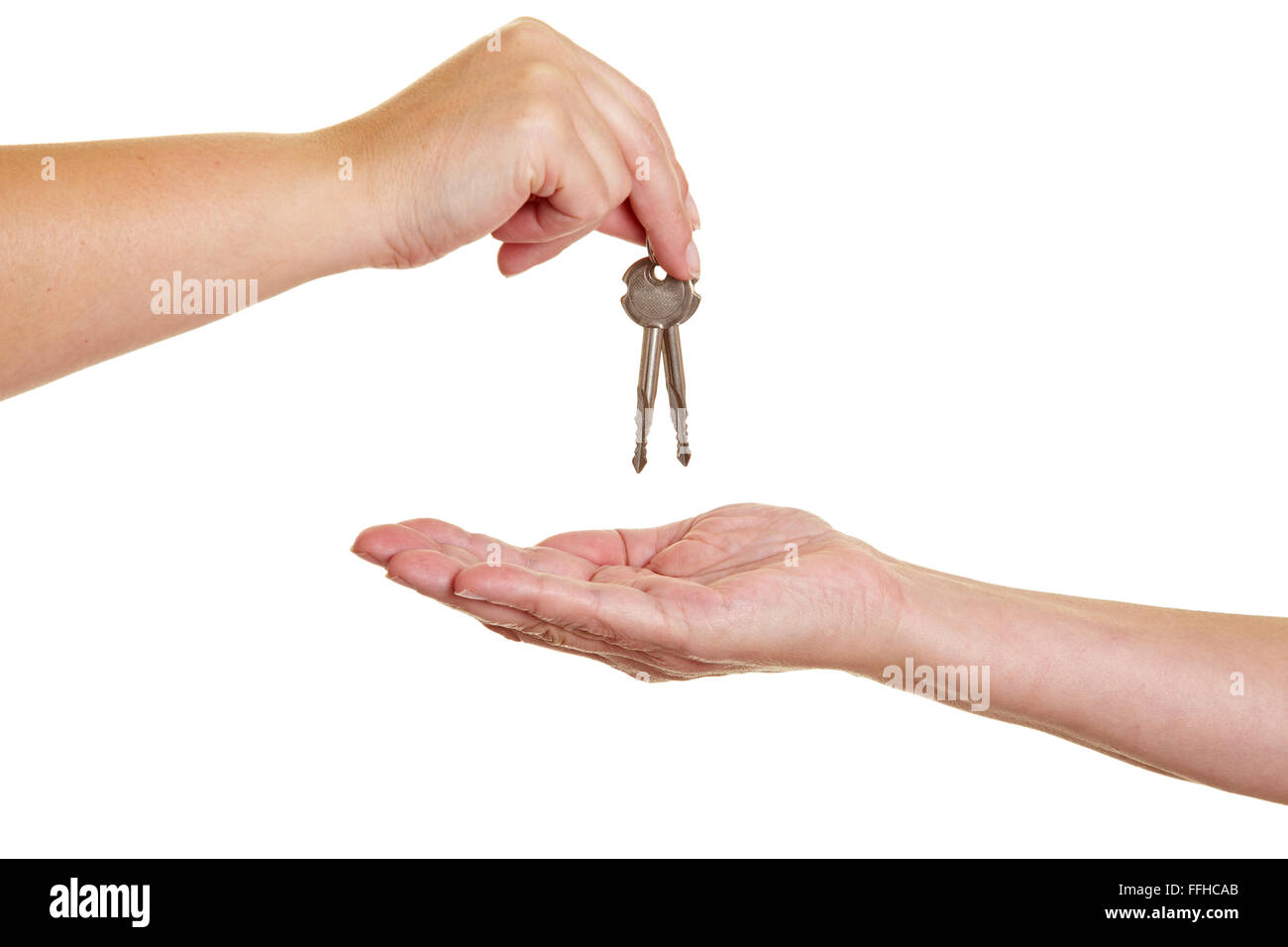 Handover of keys from one hand to another - Stock Image