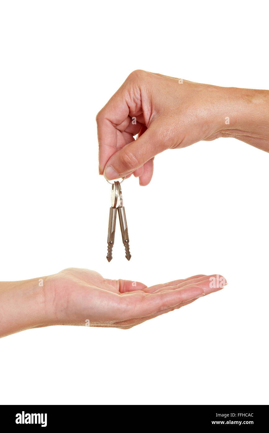 Hand offering appartment keys to another hand - Stock Image
