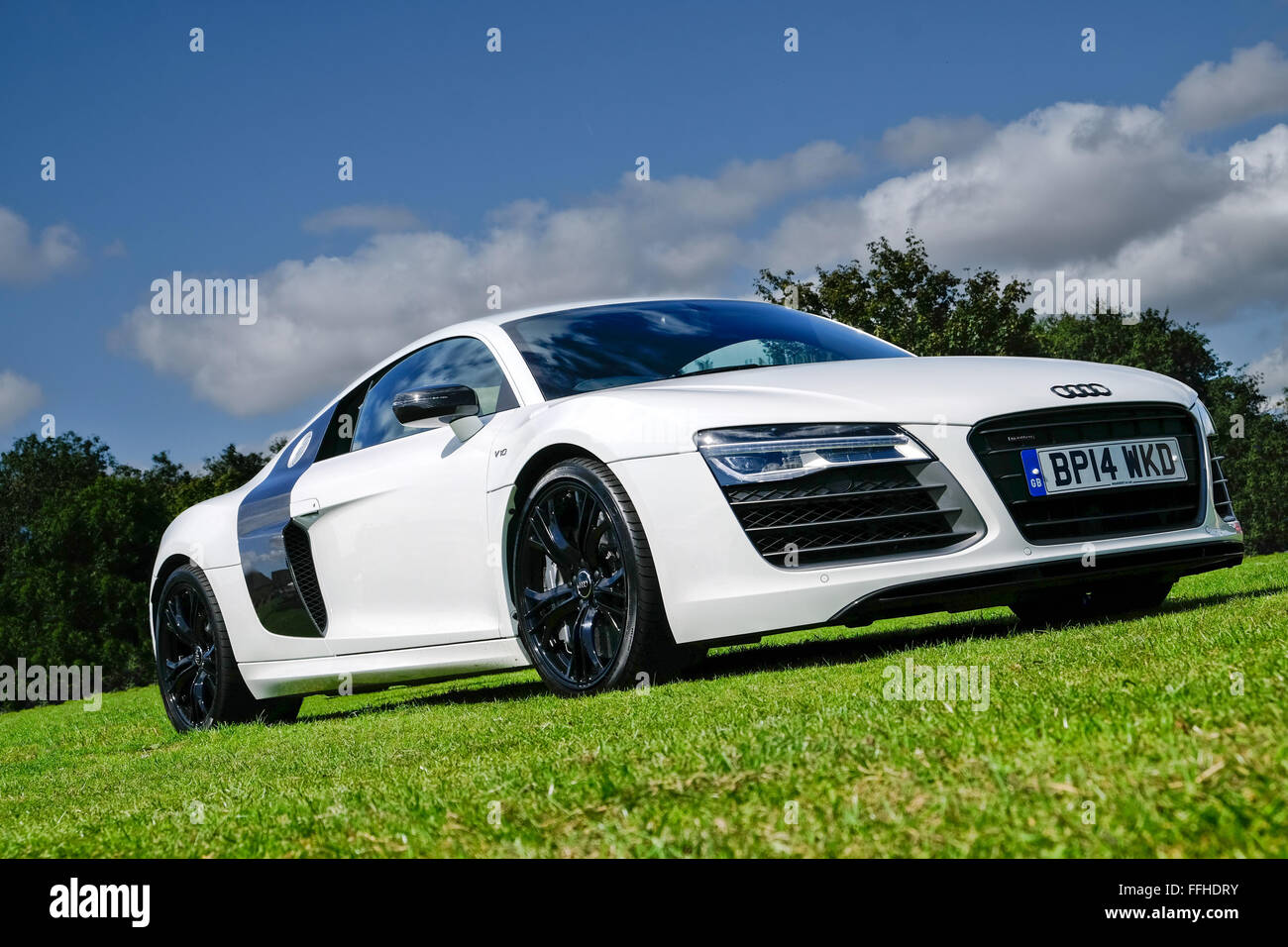 A white Audi r8 on a sunny day stood on grass - Stock Image