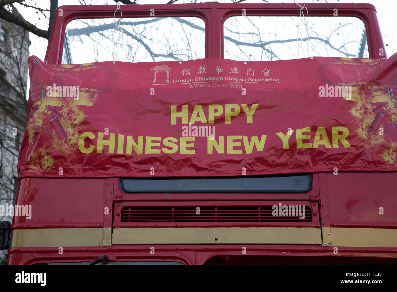 london uk 14th feb 2016 happy chinese new year banner on a routemaster bus at the chinese new year celebrations in trafalgar square londo credit keith