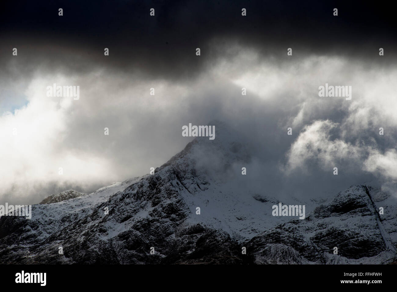 Snow topped peaks of the Black Cuillin Ridge on the Isle of Skye in Scotland - Stock Image