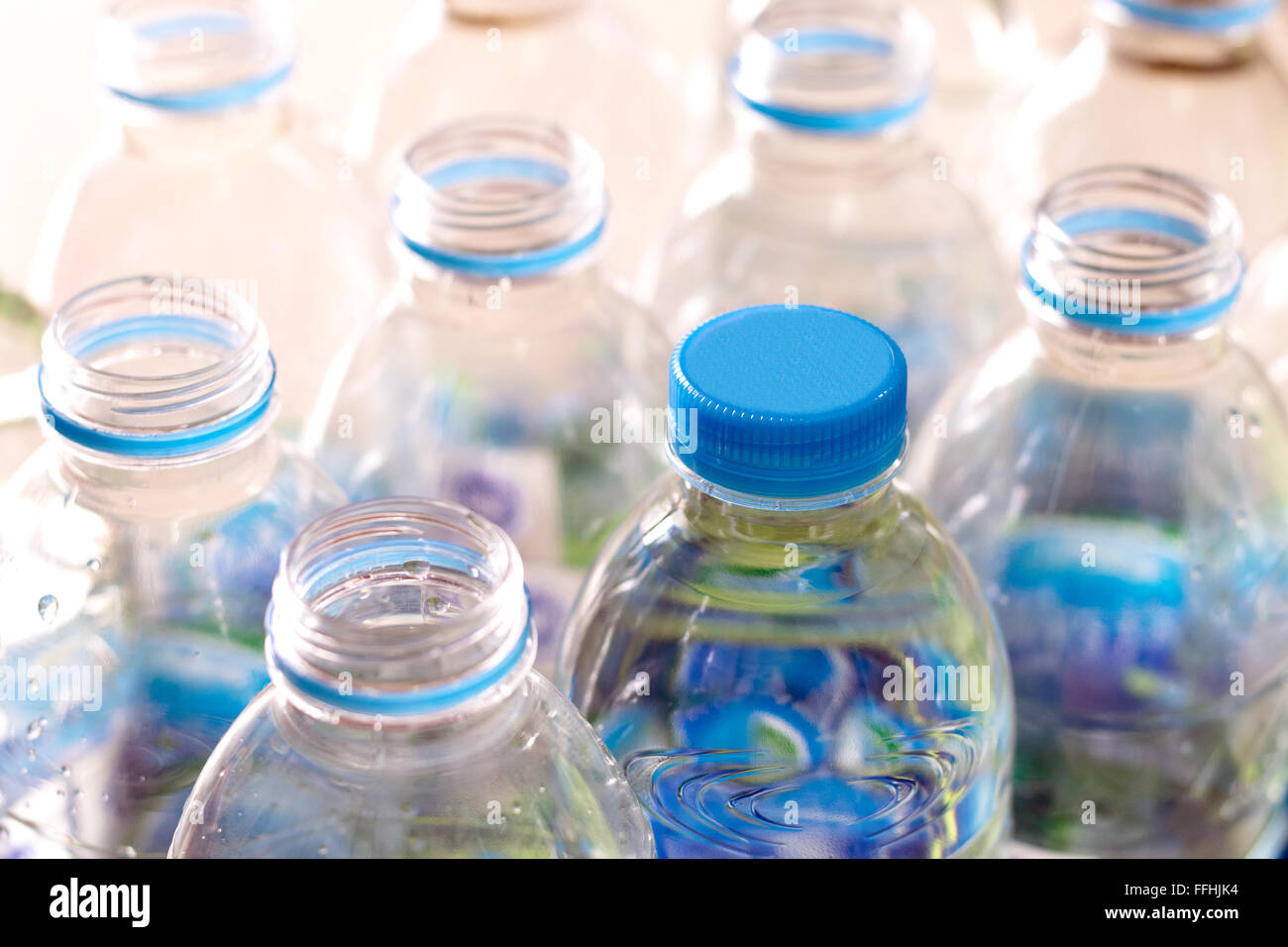 Closeup rows and pack of Plastic water bottles. - Stock Image