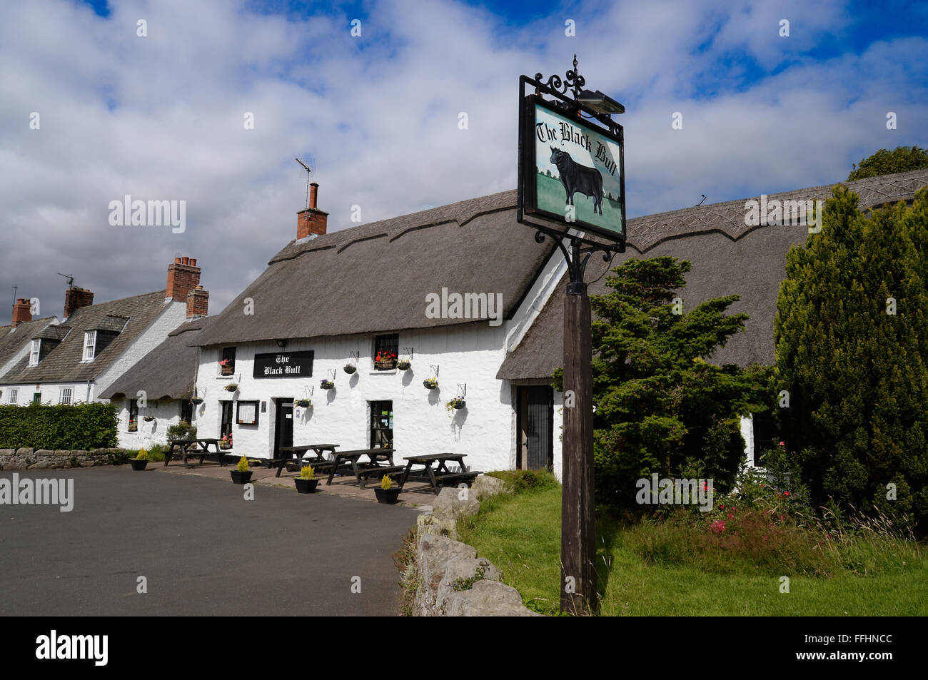Etal Castle, village and the Black Bull, north Northumberland the only thatched pub in the county. Stock Photo