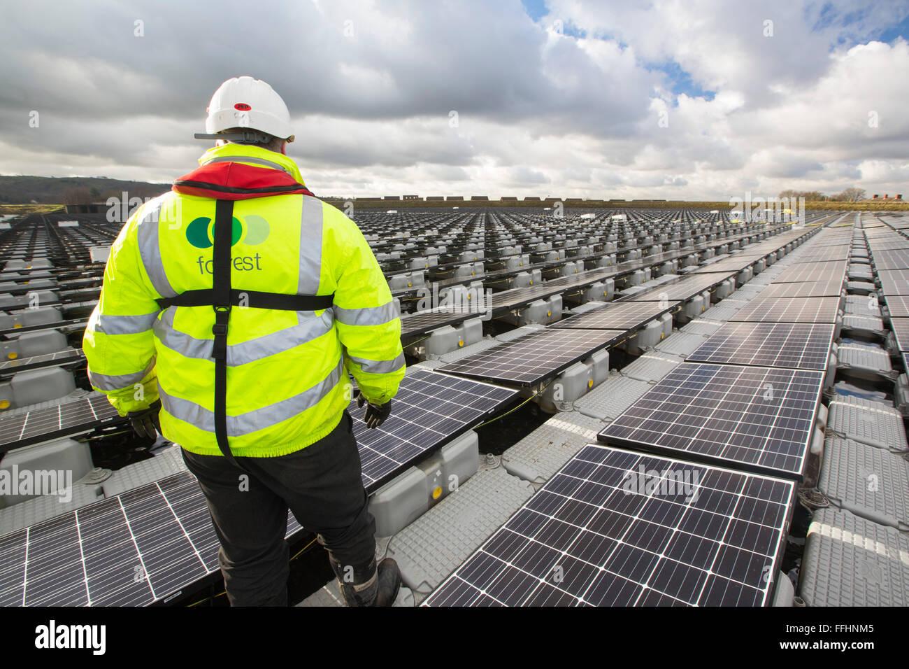 The new floating solar farm being grid connected on Godley Reservoir in Hyde, Manchester, UK. The scheme is a 3 - Stock Image