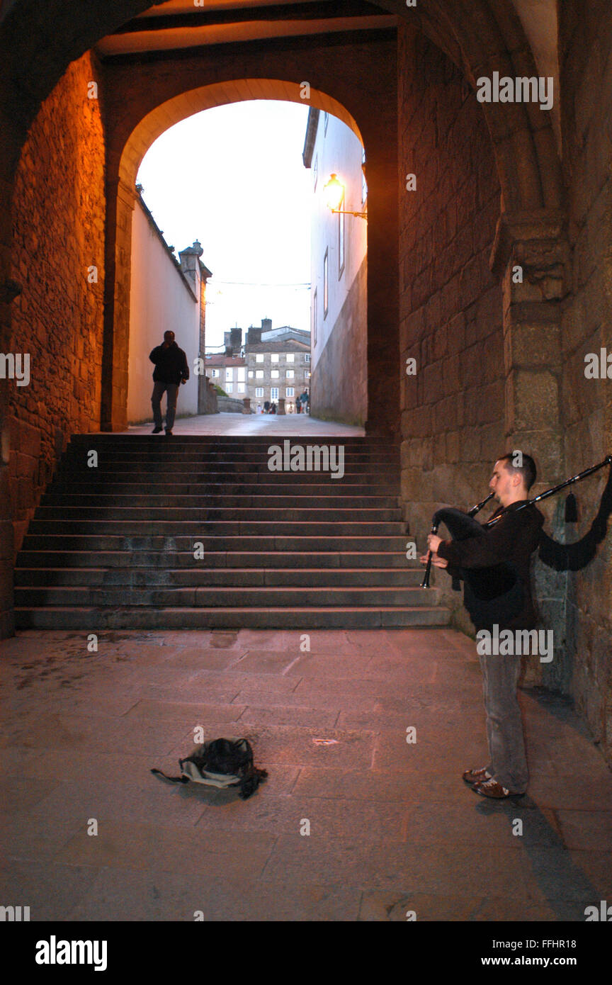 Way of St. James, Jacobean Route. Playing bagpipes in the old town of Santiago de Compostela. St. James's Way, - Stock Image