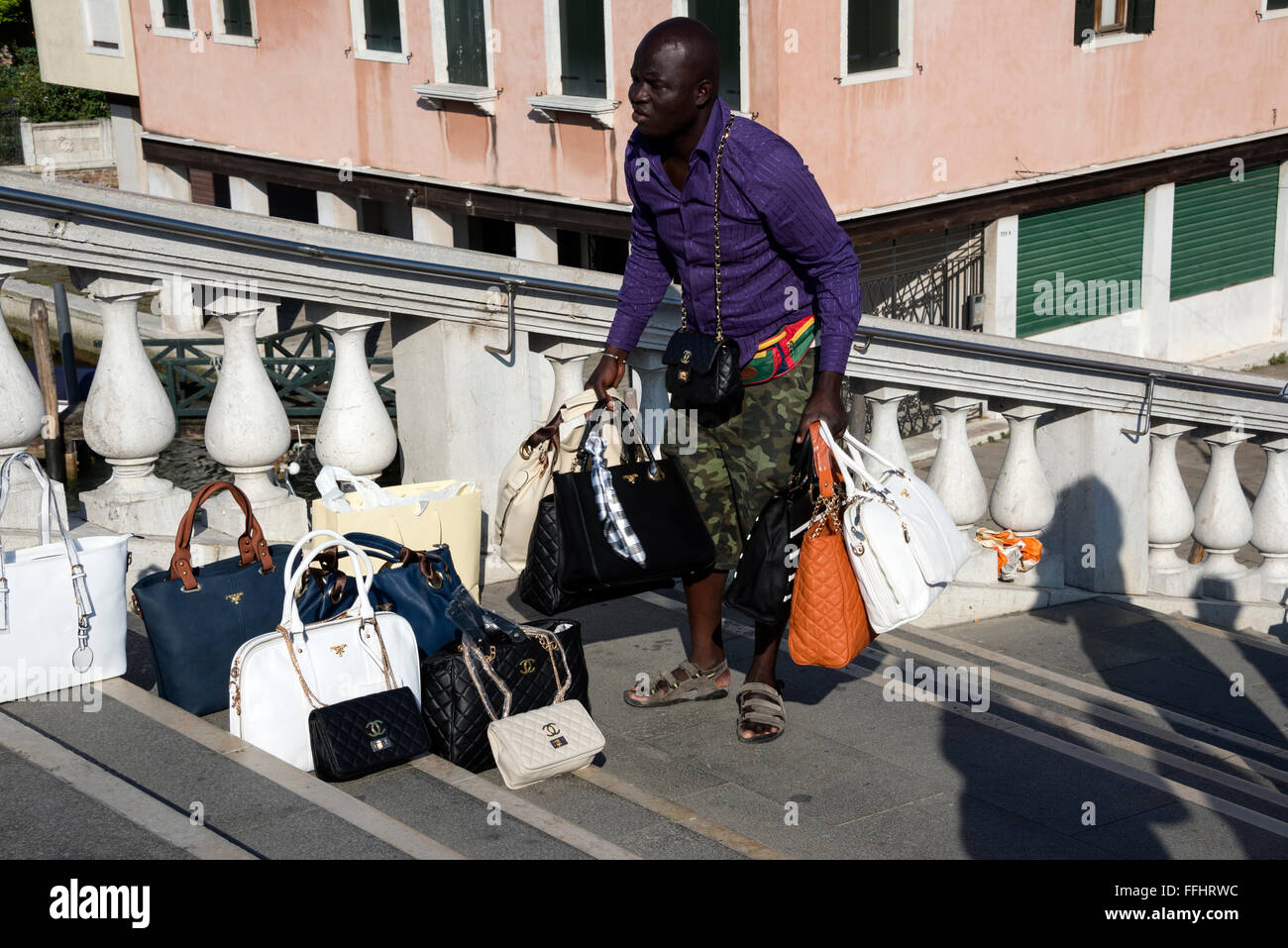 f322c4896d7d An African illegal immigrant street vendor selling counterfeit ladies  handbags such as Gucci