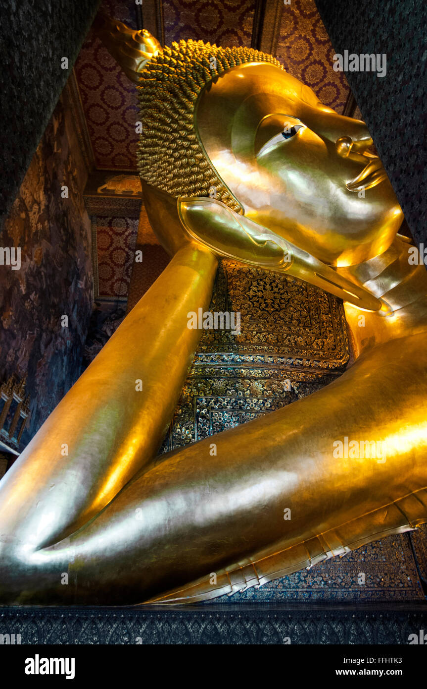 The Reclining Buddha, Wat Pho Temple, Rattanakosin Island, Bangkok, Thailand. Wat Pho (the Temple of the Reclining - Stock Image