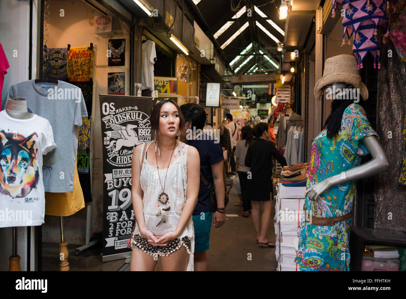 Woman buying clothes in stores at Chatuchak Weekend Market or Jatujak Market; is one of the world's largest - Stock Image