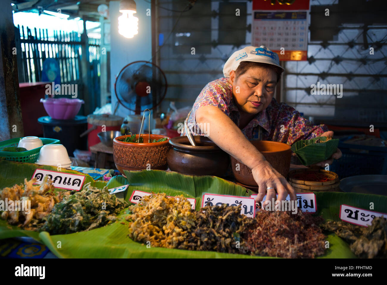 Woman seller. Food stall. Fish, vegetables, fast food. Ko Kret (also Koh Kred) is an island in the Chao Phraya River, Stock Photo