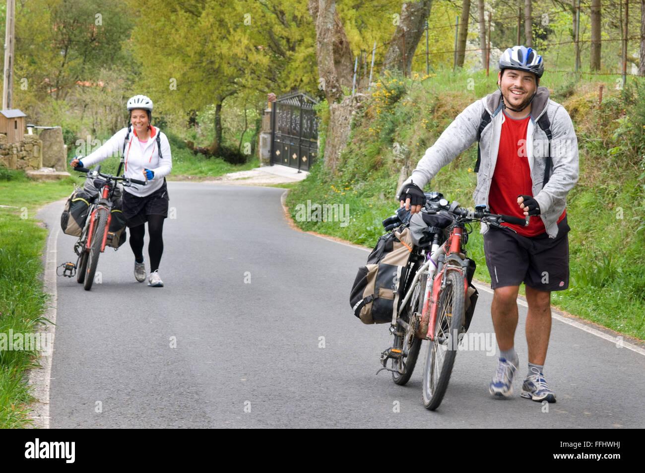 Way of St. James. A couple takes the Pilgrim bike. Around Santiago de Compostela. St. James's Way, St. James's - Stock Image