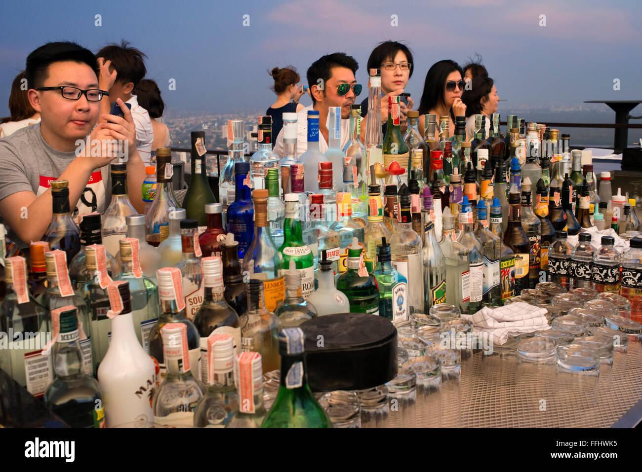 A lot of cocktails. Banyan Tree Rooftop Vertigo & Moon Bar, Restaurant, , Bangkok , Thailand. View of the city, - Stock Image