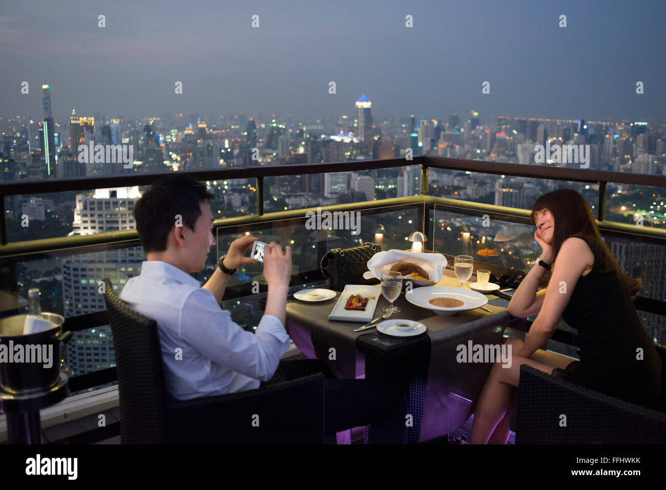 Romantic dinner. Banyan Tree Rooftop Vertigo & Moon Bar, Restaurant, , Bangkok , Thailand. View of the city, - Stock Image