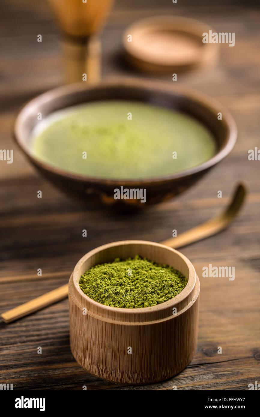 Small bamboo bowl of matcha tea powder - Stock Image