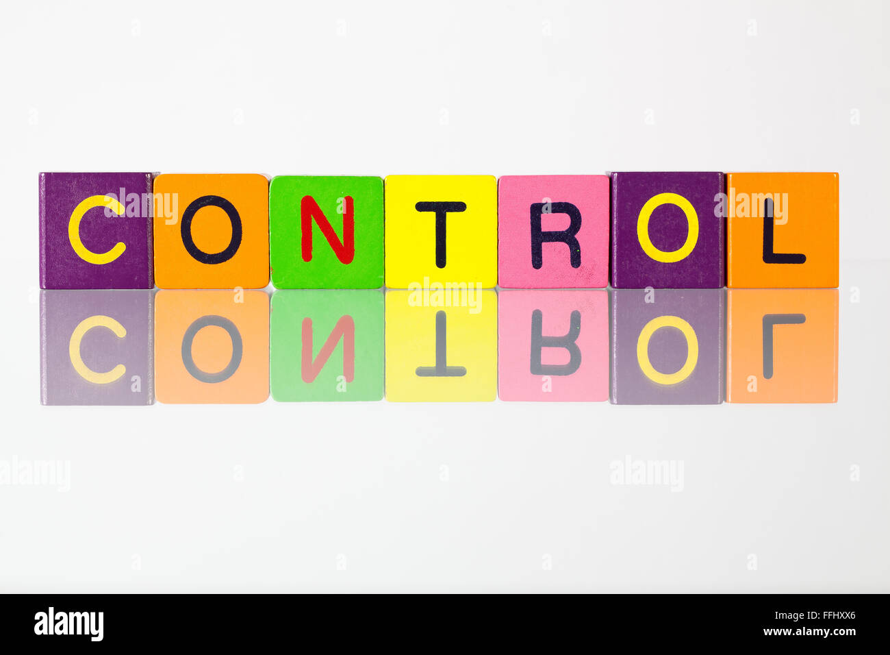 Control - an inscription from children's wooden blocks - Stock Image