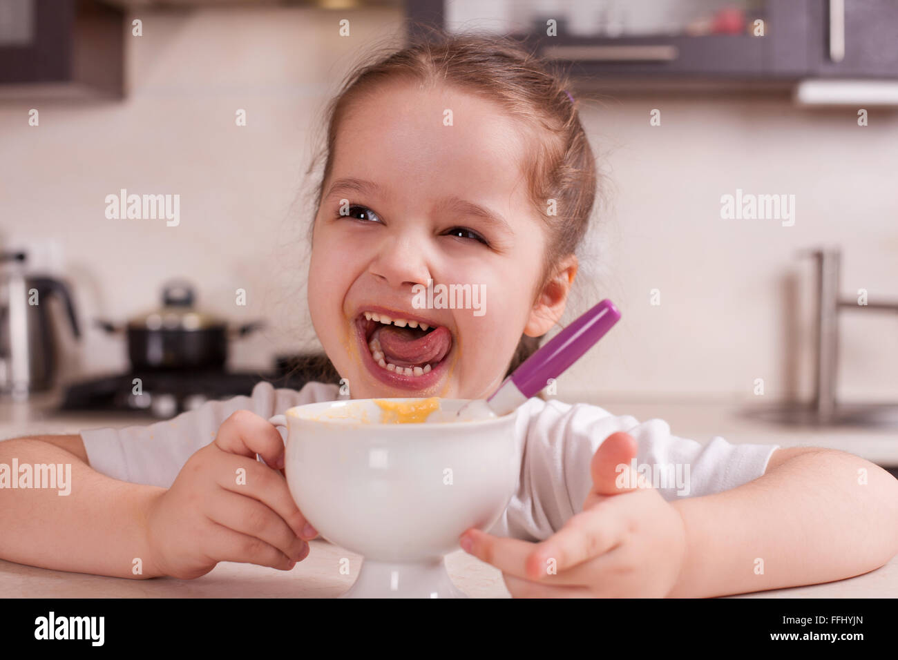 Girl spoiled and naughty food. Stock image. - Stock Image
