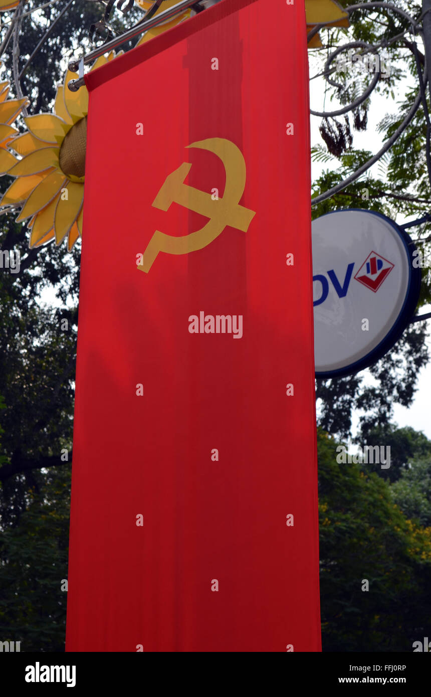 Saigon, Viet Nam. They love their flag in Saigon,they display it on every lamp post, and tree, and other wayside - Stock Image