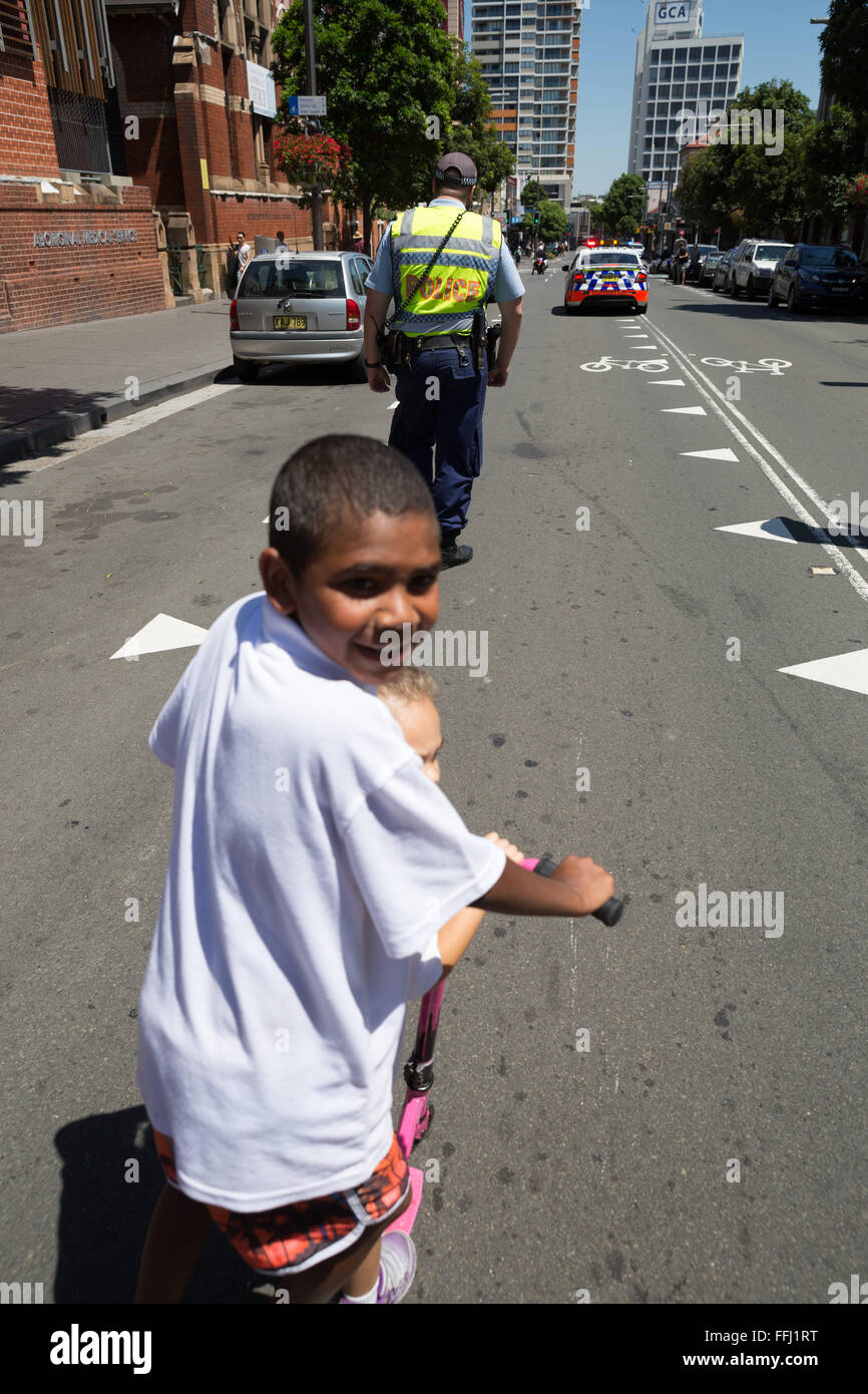 Sydney, Australia. 14th Feb, 2016. The vanguard of police are tailed by a cheeky pursuer. Rally in Sydney to commemorate - Stock Image