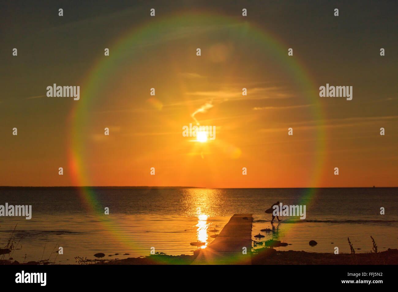 Man Surfing sunset - Stock Image