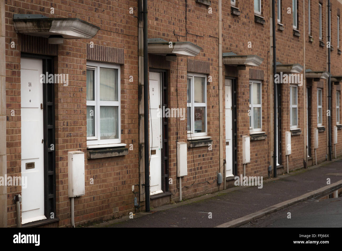 A row of identical terraced housing on a street in South West England, UK - Stock Image