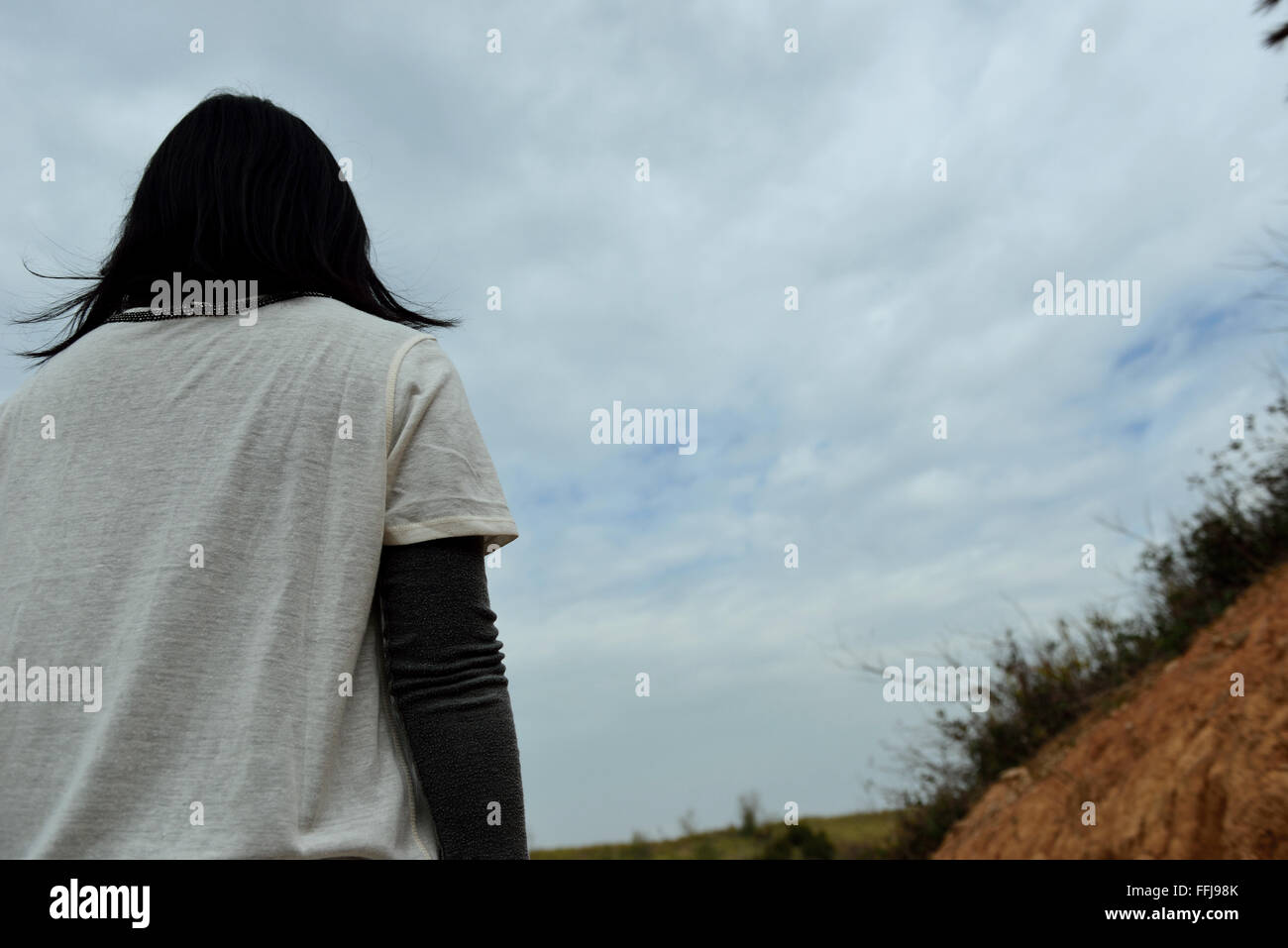 Standing on the hillside, overlooking the endless distance - Stock Image